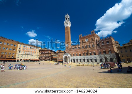 Campo Square with Mangia Tower in the background, Siena, Italy - stock photo