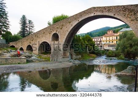 Camprodon view town bridge and little river - stock photo