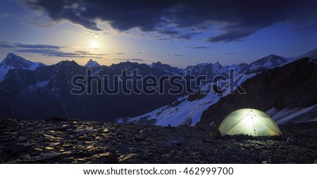 Campsite and the moon rising above the famous Matterhorn in Wallis, Switzerland. Outdoor and adventure concept.