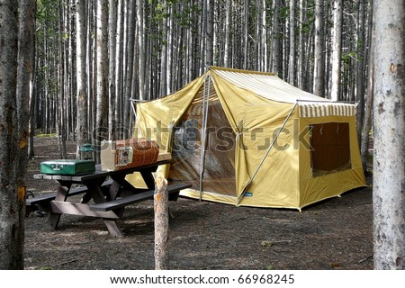 Campsite with Old-Fashioned Tent in Forest, Yellowstone National park - stock photo