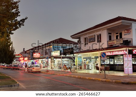 Camyuva village, Kemer, Turkey - August 26, 2014: Shops resort village in the evening, signs in Turkish, English and Russian.