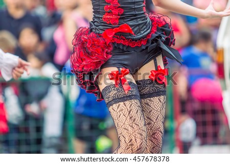 Can-Can Young Woman, Sexy Legs Dancer, Moulin Rouge Girl In The Streets Of South America  - stock photo