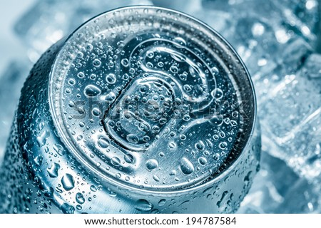 Can of soft drink on ice. - stock photo