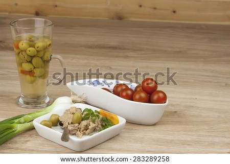 can of tuna, a healthy meal with vegetables, fast food preparation - stock photo