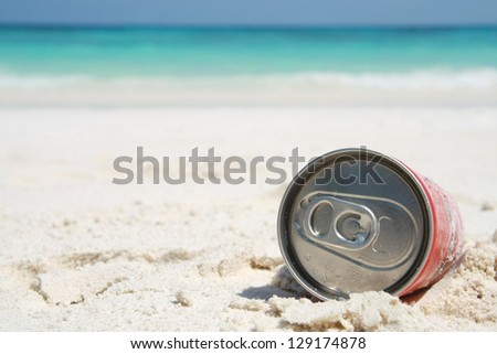 can on beach, thirsty - stock photo