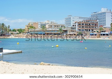 CAN PASTILLA, MAJORCA, BALEARIC ISLANDS, SPAIN - JULY 28, 2015: Sandy beach at Cala Estancia in front of hotels on a sunny summer day on July 28, 2015 in Mallorca, Balearic islands, Spain.