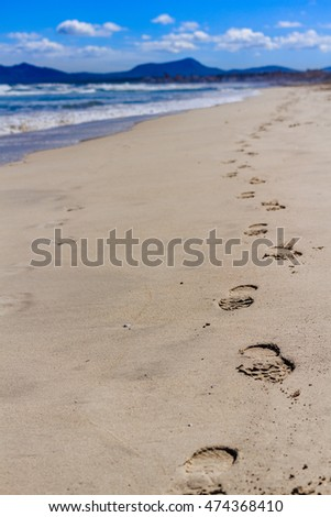 CAN PICAFORT, MAJORKA, SPAIN - MARCH, 17, 2016: Footprints at sand beach of Can Picafort, Majorka.