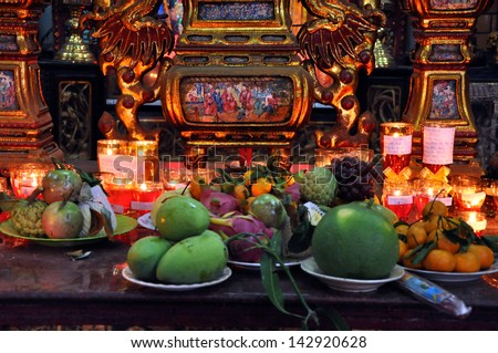 CAN THO - FEB 17: Unidentified believers offering food and incense sticks for the Gods in the Vietnamese Ong Buddhist temple. On February 17, 2013, in Can Tho, Mekong Delta, Vietnam