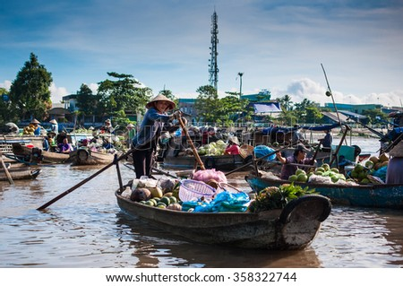 CAN THO,VIETNAM-APRIL 14: Phong Dien Floating Market, 20km from Can Tho, most famous and original floating market in Mekong Delta with local boats packed on April 14, 2012 in Can Tho, Vietnam. - stock photo