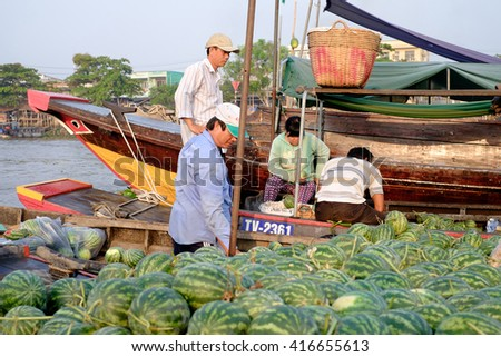 Can Tho, Vietnam - April 2, 2016: Unidentified people on Cai Rang floating market in the Mekong Delta river selling fruit and vegetables