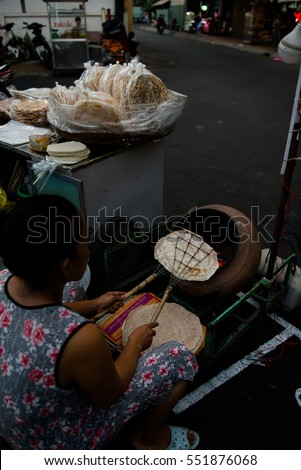 Can Tho, Vietnam - April, 02:  Women cooking and selling bread or pancakes on the streets of night market