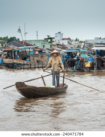 CAN THO, VIETNAM - JULY 29 2013: Vietnamese lady steers her boat towards the Phong Dien floating market in the Mekong delta 20km south west of Can Tho  - stock photo