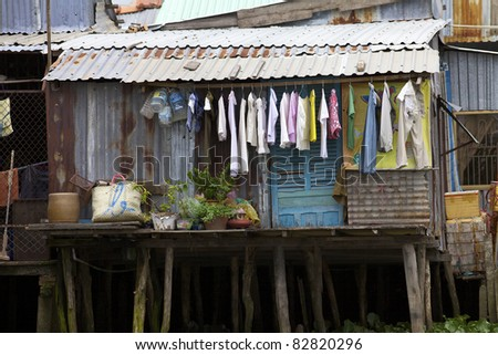 CAN THO, VIETNAM- MAY 28: A typical shack home along the Mekong Delta with laundry drying outside in Can Tho, Vietnam on May 28, 2011. Estimate 10.6% of Vietnam's population is below the poverty line.