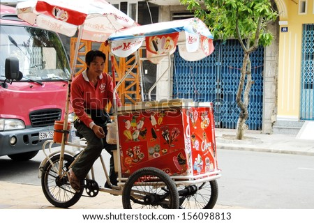 CAN THO, VIETNAM - NOVEMBER 7: Unidentified street ice cream vendor waits his customers on a street in Can Tho, Vietnam, November 7, 2008. Using of tricycles is common for street vendors in Vietnam.