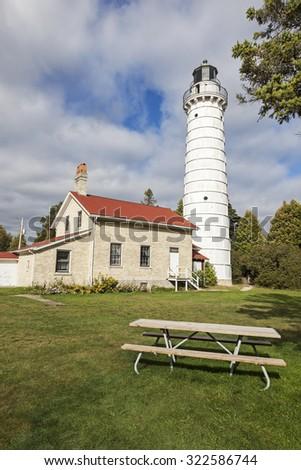 Cana Island Lighthouse and the bench. Baileys Harbor, Wisconsin, USA. - stock photo