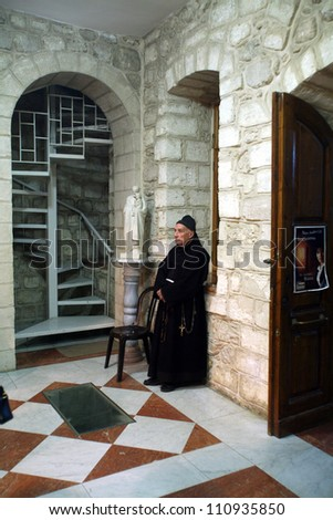 CANA , ISRAEL - DECEMBER 30: Franciscan monk in the Church of Jesus' first miracle. Franciscans in the Holy Land take care about most of the churches and shrines, Cana, Israel on December 30, 2007.