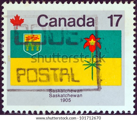 """CANADA - CIRCA 1979: A stamp printed in Canada from the """"Canada Day. Flags"""" issue shows Saskatchewan flag, circa 1979. - stock photo"""