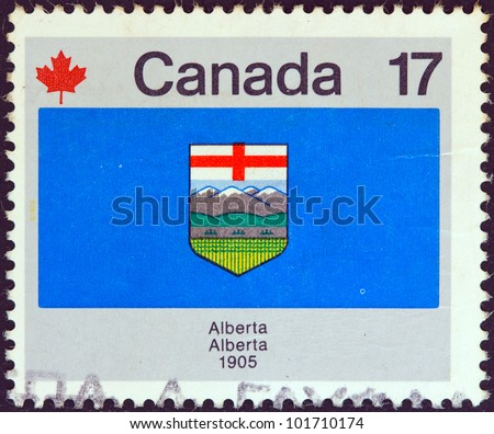 """CANADA - CIRCA 1979: A stamp printed in Canada from the """"Canada Day. Flags"""" issue shows Alberta flag, circa 1979. - stock photo"""