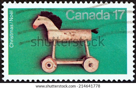 """CANADA - CIRCA 1979: A stamp printed in Canada from the """"Christmas. Toys """" issue shows Hobby-horse, circa 1979.  - stock photo"""