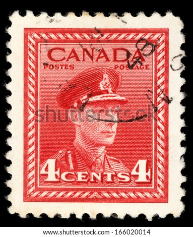 """CANADA - CIRCA 1942: A stamp printed in Canada from the """"War Effort"""" issue shows King George VI in Military Uniform, circa 1942. - stock photo"""