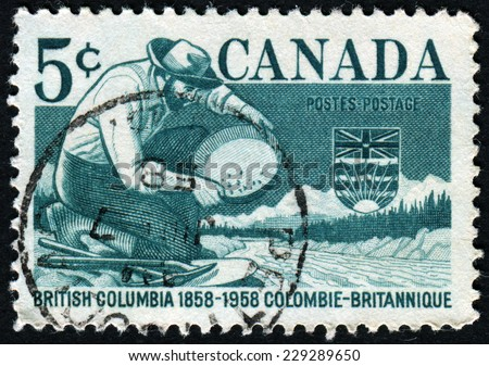CANADA - CIRCA 1958: A stamp printed in Canada shows Miner Panning Gold, circa 1958