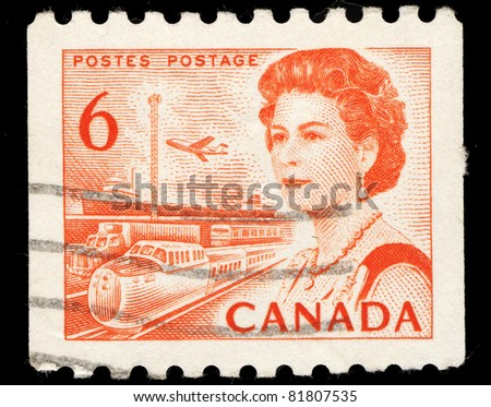 CANADA - CIRCA 1972: A stamp printed in Canada shows Queen Elizabeth II, airplane and train, circa 1972