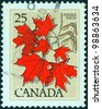 CANADA - CIRCA 1977: A stamp printed in Canada shows Sugar maple leaves, circa 1977. - stock photo