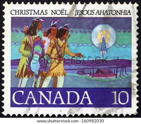 CANADA - CIRCA 1977: a stamp printed in the Canada shows Hunters Following Star, Illustration for Canada'??s first Christmas Carol, Written by Father Brebeuf, circa 1977 - stock photo