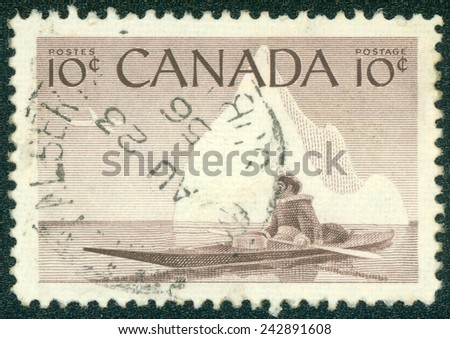 CANADA - CIRCA 1955 A stamp printed in The Canada shows image of an Inuit floating in kayak behind polar circle, circa 1955