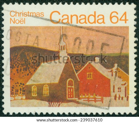 CANADA - CIRCA 1983: Brown color postage stamp printed in Canada with an artistic impression of a rural Christian church in a winter landscape to commemorate Christmas Noel. - stock photo