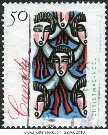 CANADA - CIRCA 1994: Postage stamp printed in Canada, Christmas Issue, shows Traditional Choir Group, circa 1994