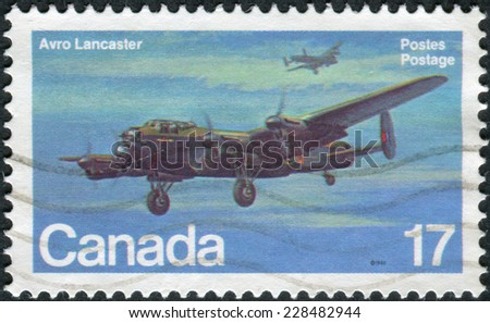 CANADA - CIRCA 1980: Postage stamp printed in Canada shows a British four-engined Second World War heavy bomber, Avro Lancaster, circa 1980 - stock photo