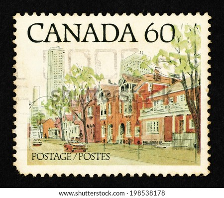 CANADA - CIRCA 1982: Postage stamp printed in Canada with image of a Canadian urban landscape. - stock photo