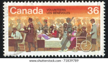 CANADA - CIRCA 1987: stamp printed by Canada, shows Volunteers, circa 1987 - stock photo