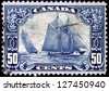 CANADA - CIRCA 1927:  Stamp printed by Canada to honor the famous racing schooner Bluenose, circa 1927 - stock photo