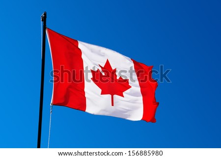 Canada flag on blue background - stock photo