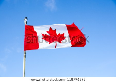 Canada flag on blue sky  background - stock photo