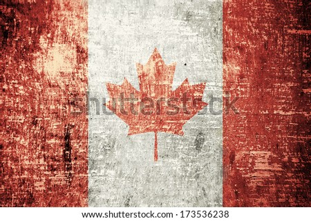 Canada flag on old wood texture background - stock photo