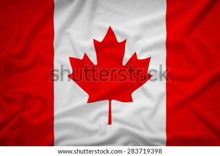 Canada flag on the fabric texture background,Vintage style - stock photo