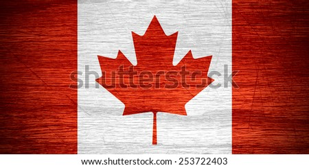 Canada flag or Canadian banner on wooden texture