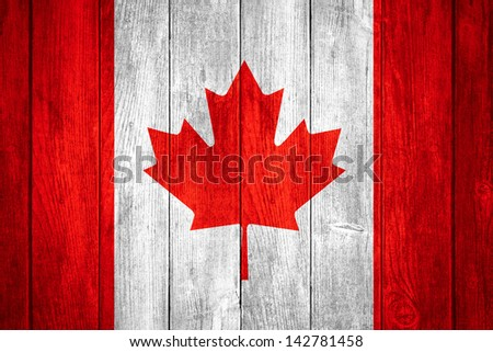 Canada flag or white or red and white Canadian banner on wooden background - stock photo