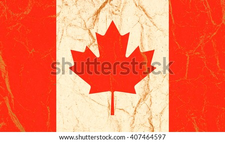 Canada flag painted on crumpled paper background