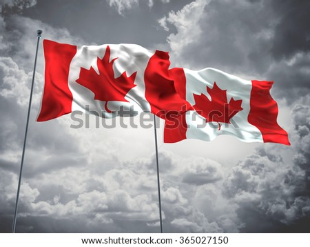 Canada Flags are waving in the sky with dark clouds
