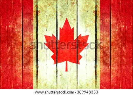 Canada grunge wooden flag. Canada flag painted on the old wooden planks. Vintage retro picture from my collection of flags.