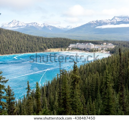 Canada, Rocky Mountains: view point above lake Louise with view at the frozen lake and also the hotel Fairmont Chateau
