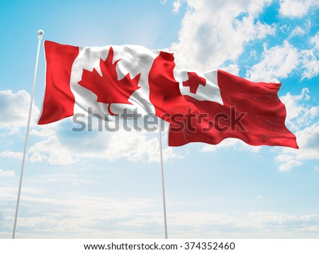 Canada & Tonga Flags are waving in the sky