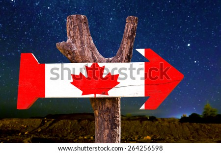 Canada wooden sign with a beautiful night - stock photo