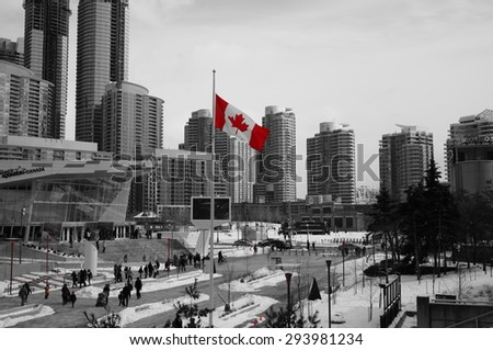 Canadian flag color splash downtown toronto - stock photo
