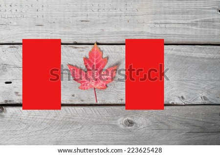 Canadian flag concept made of a red maple leaf and two red rectangles - stock photo