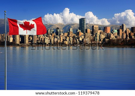Canadian flag in front of the beautiful city of Vancouver, Canada. - stock photo